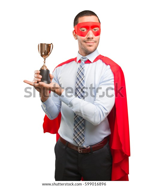 Concept of a winner super businessman with a gold cup