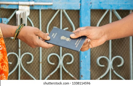 Concept of woemn receving passport at the door step of the house in India