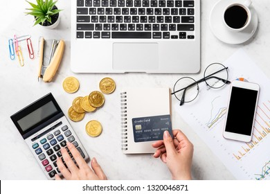 concept of a woman doing online payment with card and smartphone isolated on a modern marble office table, mock up, top view, copy space, flat lay, lifestyle, close up