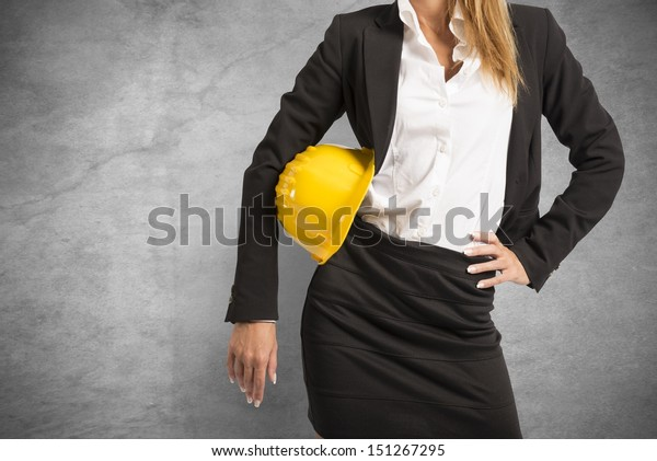Concept of woman at work with yellow helmet