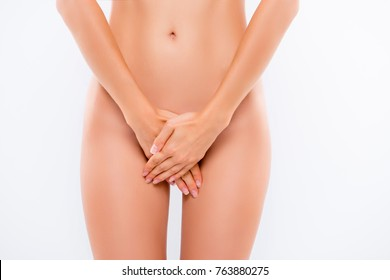 Concept of woman's intimate life. Cropped close up photo of woman's hands covering the intimate zone, she is shy and confused without underwear, isolated on white background