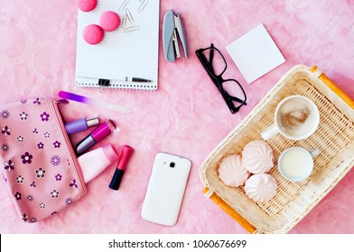 The concept of women's morning, ritual, cosmetics, notebook and smartphone. Flat sheet, pink background, work.