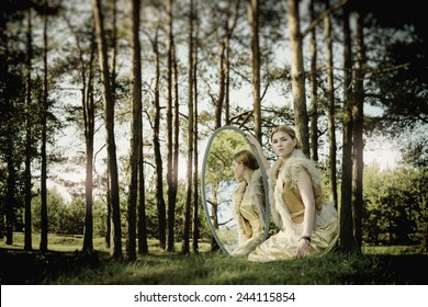 concept of wonderful fairy tale with beautiful girl in country of mirror