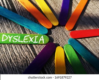 concept of word - DYSLEXIA on ice-cream sticks over wooden background with shadow/selective.