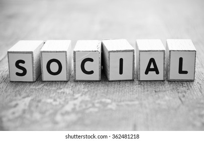 concept word forming with cube on wooden desk background - Social