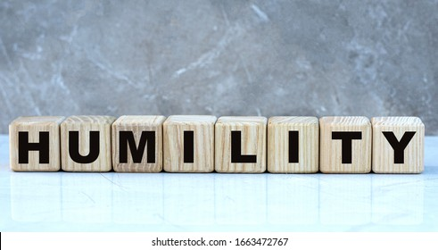 concept word humility on cubes on a beautiful gray background