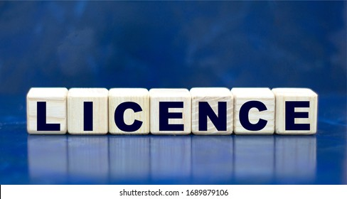 concept word LICENCE on cubes on a blue background