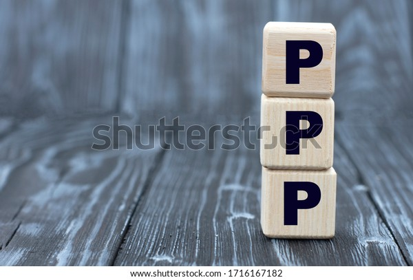 concept word PPP on cubes on a beautiful gray blue background
