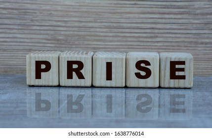 concept word prise on wooden cubes on a gray background - Shutterstock ID 1638776014