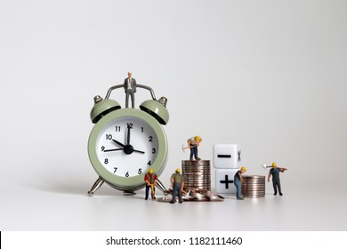 The concept of working hours and wage calculations. Miniature working people with piles of coins.