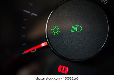 Conception of driving a car carefully with lights turn on.