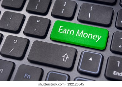 concepts of earning money through internet, with a message on enter key of keyboard.