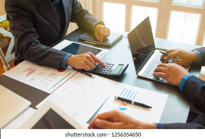 Concepts, evaluation and business planning.Business consultants are calculating profits and providing financial advice to business owners.