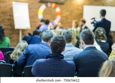 Concepts and Ideas of Mediation and Low Made Public. Young  Professional Mediators Having a Public Discussion at the Round Table on Stage Before the Audience. Horizontal Image Orientation
