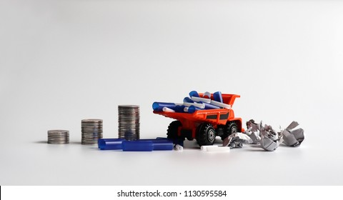 Concepts for increased waste disposal costs. Miniature cars and piles of coins.