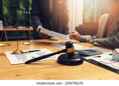 Concepts of law, Lawyer and businessman working and discussing business contract papers in office.