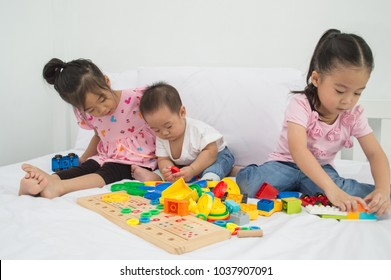 Concepts of learning skills. Little Children are learning skills to play with toys. Little Children are playing in the playroom. Asian Little Children playing with friends in the bedroom