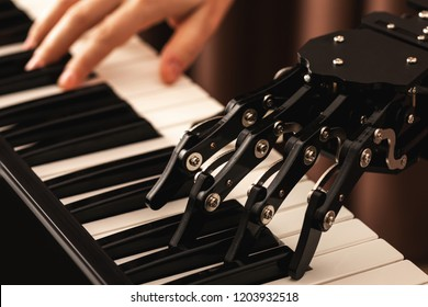 Concepts of prosthetics or artificial intelligence. Human with neural hand prosthesis playing piano