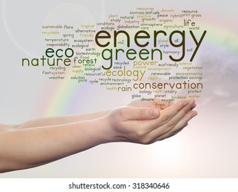 Conceptual abstract green ecology, conservation word cloud text in man hand on rainbow sky background for environment, recycle, earth, clean, alternative, protection, energy, eco friendly or bio