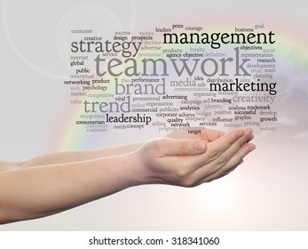 Conceptual abstract word cloud or wordcloud in man or woman hand on rainbow sky background, metaphor to  business, trend, media, focus, market, value, product, advertising, customer or  corporate