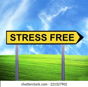 Conceptual arrow sign against beautiful landscape with text - STRESS FREE