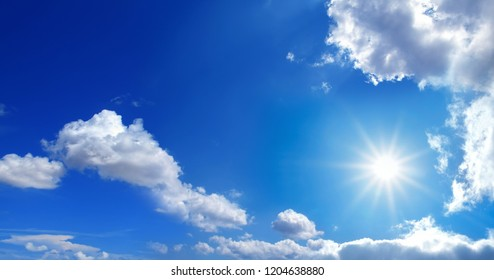 conceptual background image of blue sky with clouds and shining sun
