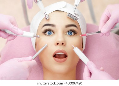 Conceptual beauty and cosmetology image of the hands of several beauticians holding their respective equipment. Beauty concept. Cosmetology concept. Cosmetology salon. Cosmetic procedures mesotherapy