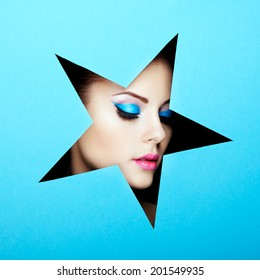 Conceptual beauty portrait of beautiful young woman. Cosmetic Eyeshadows. Fashion photo