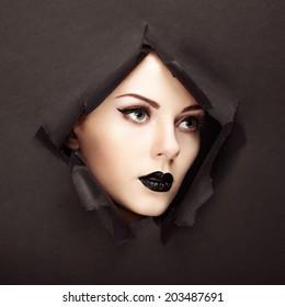 Conceptual beauty portrait of beautiful young woman. Perfect Manicure.  Cosmetic Eyeshadows. Fashion photo
