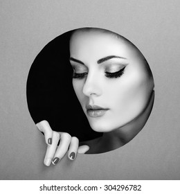 Conceptual beauty portrait of beautiful young woman. Perfect Manicure.  Cosmetic Eyeshadows. Fashion photo. Black and white