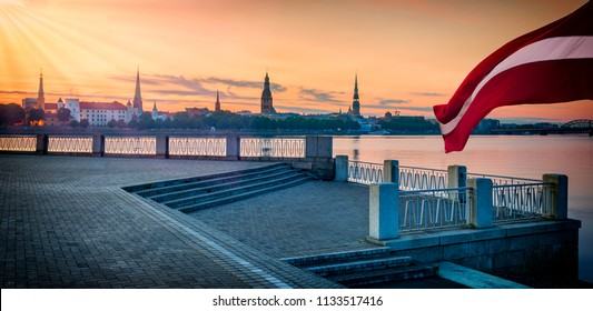 Conceptual collage image symbolizing 100 years of Latvian State Independence. Flag of Latvia is above ancient buildings of Riga - the capital of Latvia known by unique medieval and Gothic architecture
