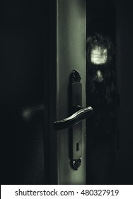 Conceptual composition about safeness, somebody unknown is behind the door.