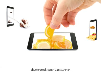 A conceptual creative 3D volumetric photo of a hand stretches in a glass jar with colorful candy in the glaze that goes beyond the screen of a smartphone isolated on a white background.