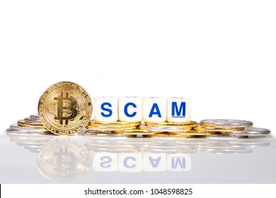 Conceptual cryptocurrency bitcoin with the word Scam on white background