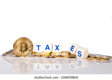 Conceptual cryptocurrency bitcoin with word Taxes breaking up on white background