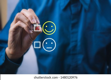 Conceptual the customer responded to the survey. The client using digital pen checkbox on happy face smile icon. Depicts that customer is very satisfied. Service experience and satisfaction concept.