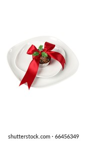 a conceptual decorated fruitcakes with red christmas ribbon on a plate