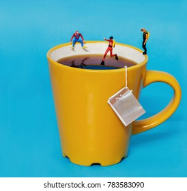conceptual diver jumping in a tea cup