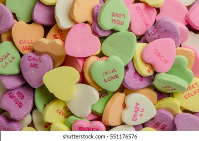 Conceptual Editorial: Multi colored candy with sweet romantic messages are popular treats around Valentine's Day