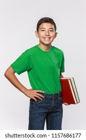 A conceptual education photo of a student holding school books.