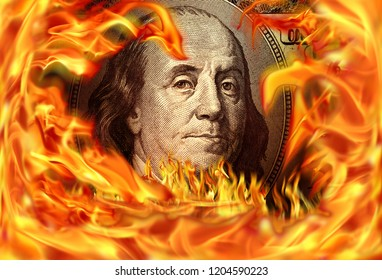 Conceptual finance image of burning dollar bill and fire flames