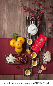 Conceptual flat lay Chinese New Year food and drink still life. Text appear in image: Prosperity.