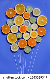 conceptual fresh fruit bouquet isolated on blue
