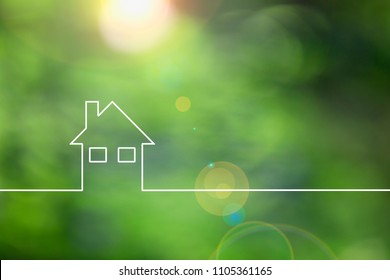Conceptual green eco house icon on sunny blurred bokeh copy space background.
