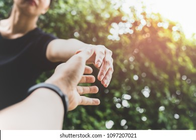 Conceptual hand reach out for help with light fare in matte color