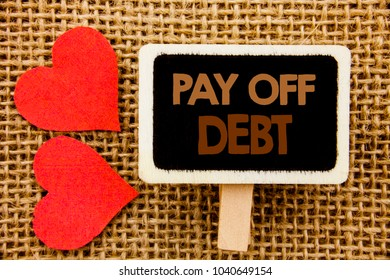 Conceptual hand text showing Pay Off Debt. Business photo showcasing Reminder To Paying Owed Financial Credit Loan Bills written blackboard the textured background with Love Heart