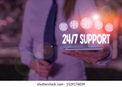 Conceptual hand writing showing 24 Or 7 Support. Business photo showcasing Giving assistance to service whole day and night No downtime Woman wear work suit presenting presentation smart device.