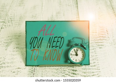 Conceptual hand writing showing All You Need To Know. Business photo showcasing Tell only the Facts and Important ones Access to Data Alarm clock tilted above buffer wire in front of notepaper.