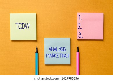 Conceptual hand writing showing Analysis Marketing. Business photo showcasing Quantitative and qualitative assessment of a market Front view colored sticky note ballpoints yolk background.