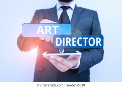 Conceptual hand writing showing Art Director. Business photo showcasing responsible for overseeing the artistic aspects of a film Male human wear formal work suit hold smartphone using hand.